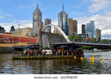MELBOURNE, VIC, AUSTRALIA - NOVEMBER 03: Unidentified people in cafe at Evan Walker bridge in midst Yarra river, preferred place for tourists and Melburnians, November 03, 2017 in Melbourne, Australia