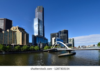 MELBOURNE, VIC, AUSTRALIA - NOVEMBER 03: Different buildings, Eureka tower and Evan Walker foot bridge over Yarra river in the capital of Victoria, on November 03, 2017 in Melbourne, Australia