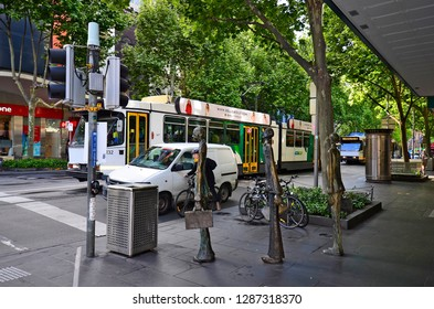 MELBOURNE, VIC, AUSTRALIA - NOVEMBER 03: Unidentified people, traffic and Swanston Walk Sculptures in the capital of Victoria, on November 03, 2017 in Melbourne, Australia