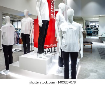 Melbourne, VIC Australia-June 27th 2018: Mannequins dressed in casual T-shirt with logo of Debenhams department store in St Collins Lane shopping centre.