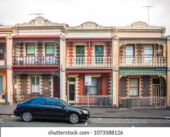 Melbourne, VIC/Australia-April 21st 2018: Car parked at front of old Victorian style terraced houses.