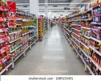 Melbourne, VIC/Australia-May 13th 2018: aisle between shelves packed with a variety of food products in Coles Supermarket.
