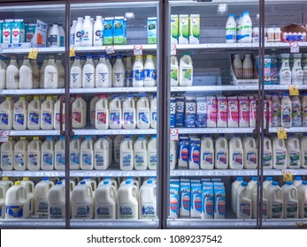 Melbourne, VIC/Australia-May 13th 2018: Different brands of milk displayed in fridge in supermarket