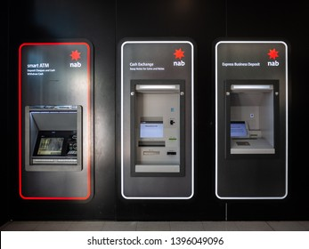 Melbourne, VIC/Australia-May 7th 2019: ATM, Cash Exchange Machine and Express Business Deposit Machine of National Australia Bank on wall.