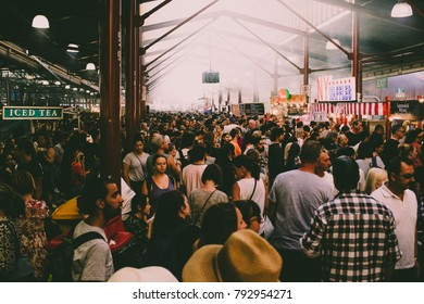Melbourne, Victoria / Australia - 01/10/2018: Anonymous crowd at bustling market