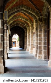 MELBOURNE, VICTORIA, AUSTRALIA - 02 MARCH 2014: The historic vaulted archways of the Old Quadrangle courtyard at Melbourne University date back to the 1850's and is the oldest building on campus.