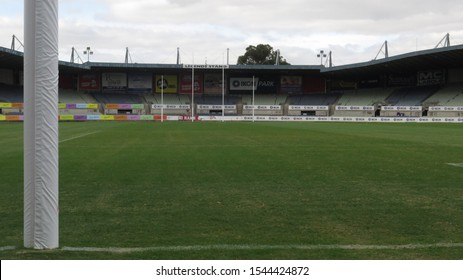 Melbourne, Victoria, Australia 04/28/2018 Green grass and goal post with clouds sky background at Ikon Park Stadium former home ground of the Carlton Blues football club