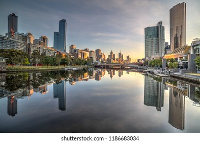 Melbourne, Victoria / Australia - 11.11.15: Melbourne CBD reflected in the mirror like finish of the pre-dawn Yarra River.