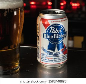 Melbourne, Victoria, Australia, 17/12/19:Pabst Blue Ribbon Beer amongst food on a table