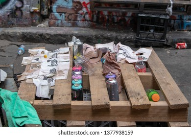 Melbourne, Victoria / Australia - April 22 2019: Makeshift table out of a pallet  holding old used spray paints cans.
