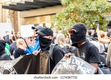 Melbourne, Victoria, Australia, August 25, 2018: Masked protestors on Bourke Street in Melbourne Australia.