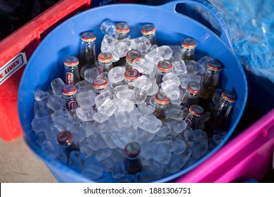 Melbourne, Victoria, Australia, December 31, 2014:View of a blue plastic tub full of ice and bottles of beer at a suburban backyard party