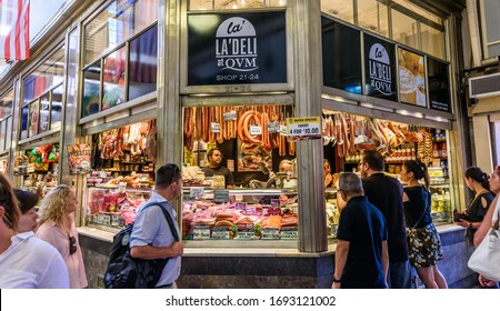 Melbourne, Victoria, Australia, February 23, 2020 :An unidentified group of people are shopping at a Queen Victoria Market stall.