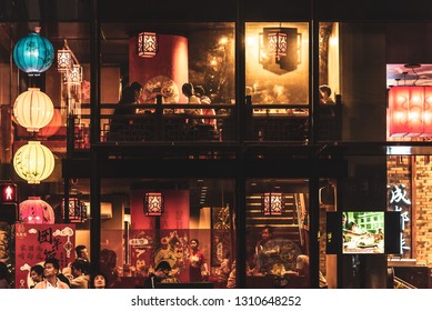 Melbourne, Victoria, Australia, February 9, 2019: People are dining in a multi level asian restaurant decorated with traditional paper lanterns