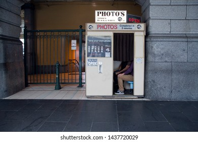 Melbourne, Victoria / Australia - January 08 2016:  Young couple capture memories in an old photo booth at Flinders Street Railway Station, in Melbourne, Australia.