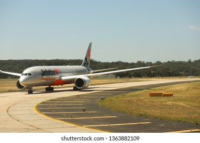 Melbourne, Victoria, Australia, January 23 2019 : Jetstar plane on runway at melbourne airport on a hot sunny day