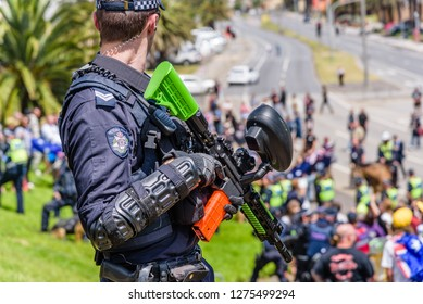 Melbourne, Victoria, Australia, January 5th 2019: Left and right wing political groups face off against each other at St Kilda beach while Victoria Police attempt to keep them apart.
