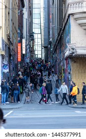 Melbourne, Victoria / Australia - July 06 2019: Hugely popular tourist spot, Hosier lane, filled with people wanting to see the walls lined with street art