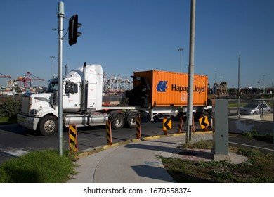 Melbourne, Victoria / Australia - Mar 10 2020:  A Hapag Lloyd shipping container on a truck leaving the West Swanson Dock terminal at Coode Island in the Port of Melbourne, Victoria, Australia.