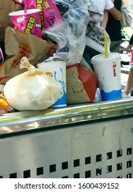 Melbourne, Victoria AUSTRALIA - March 12, 2013: Overflowing Rubbish Bin with Fast Food Packaging