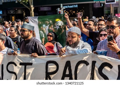 Melbourne, Victoria, Australia, March 16th, 2019: People are attending a political rally and marching through the city streets of Melbourne with a police escort