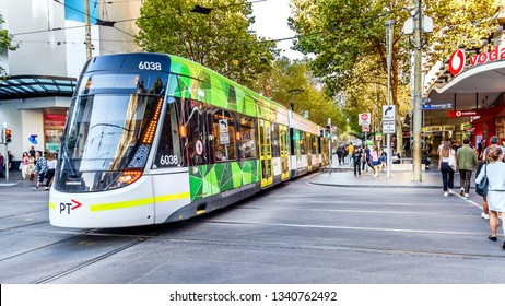 Melbourne, Victoria, Australia, March 16th, 2019: A Melbourne city tram is crossing Swanston Street into the Bourke Street Mall