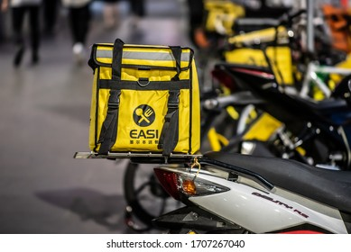 Melbourne, Victoria, Australia, November 30th, 2019: A takeaway food delivery motorcycle is parked in the city of Melbourne