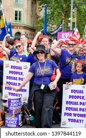 Melbourne, Victoria / Australia - October 23 2018: Women and young girl protesting for equal pay at the change the rules workers union rally in central Melbourne. Outfits referencing Rosie the Riveter