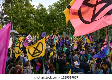 "Melbourne, Victoria, Australia: October-11-2019: Protestors of Extinction Rebellion engaging in peaceful ""Disco Disruption"" protest - Extinction Rebellion protestors gather in numbers"