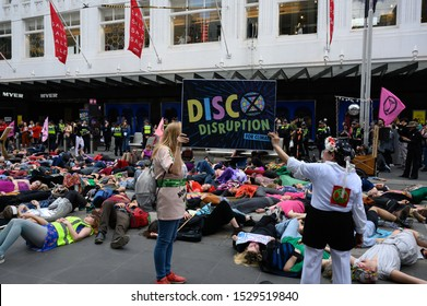 "Melbourne, Victoria, Australia: October-11-2019: Protestors of Extinction Rebellion engaging in peaceful ""Disco Disruption"" protest - Protestors from Extinction Rebellion occupy Bourke Street Mall"