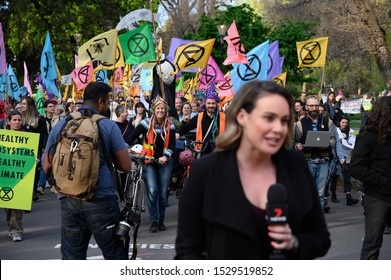"Melbourne, Victoria, Australia: October-11-2019: Protestors of Extinction Rebellion engaging in peaceful ""Disco Disruption"" protest - Extinction Rebellion draws mainstream media attention"