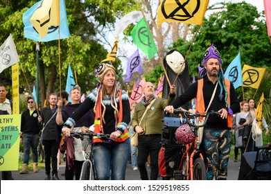 "Melbourne, Victoria, Australia: October-11-2019: Protestors of Extinction Rebellion engaging in peaceful ""Disco Disruption"" protest - Disco Disruption Rave walk begins"
