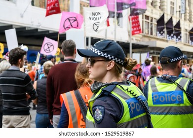 "Melbourne, Victoria, Australia: October-11-2019: Protestors of Extinction Rebellion engaging in peaceful ""Disco Disruption"" protest - Police presence at Extinction Rebellion's Disco Disruption protest"