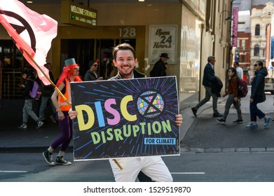 "Melbourne, Victoria, Australia: October-11-2019: Protestors of Extinction Rebellion engaging in peaceful ""Disco Disruption"" protest - Peaceful protestor engaging in ""Disco Disruption"""