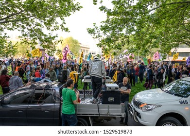 "Melbourne, Victoria, Australia: October-11-2019: Protestors of Extinction Rebellion engaging in peaceful ""Disco Disruption"" protest - Garden Rave organised at end of weeklong protests"