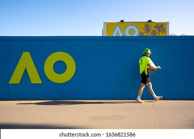 Melbourne, Victoria, Australia, Wednesday 29 January 2020 : Man walking pass Logo of Australian open in 2020 at Melbourne park