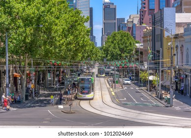 MELBOURNE, VICTORIA/AUSTRALIA  December 24: A view down Bourke street on a sunny day with people riding trams and crossing the road in, Melbourne Victoria, Australia on December 24, 2017.