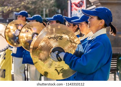 MELBOURNE, VICTORIA/AUSTRALIA JULY 14 2018: A Chinese marching band wearing blue jackets and white pants is assembled in front of the State Libary of Victoria.