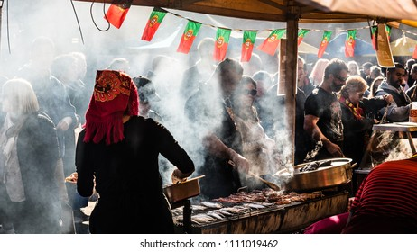 MELBOURNE, VICTORIA/AUSTRALIA JUNE 10: Unidentified stall holders are cooking and selling street food during the Portuguese street festival at the Queen Victoria Market on June 10, 2018