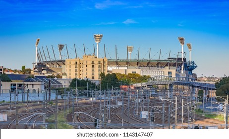 MELBOURNE, VICTORIA/AUSTRALIA June 2 2018: The Melbourne Cricket Ground also known as the MCG with its large lighting towers in the background and Melbourne city railway tracks in the foreground
