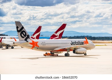 MELBOURNE, VICTORIA/AUSTRALIA, MARCH 17TH: Image of a Jetstar passenger airliner taxiing and Qantas airliner at Melbourne Airport on 17th March, 2014 in Melbourne