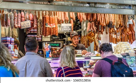 MELBOURNE, VICTORIA/AUSTRALIA MARCH 3: An unidentified male is serving customers at a delicatessen stall at Queen Victoria Market on March 3, 2018