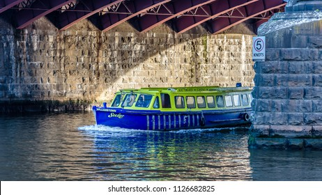"MELBOURNE, VICTORIA/AUSTRALIA MAY 26: A blue and green Yarra River ferry called the ""Williamstown Seeker"" is making way inder the Princess Street Bridge in Melbourne, Australia on May 26, 2018"