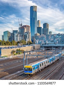 MELBOURNE, VICTORIA/AUSTRALIA May 26: The many high rise buildings of Southbank in the city of Melbourne with a Metro train in the foreground in the late afternoon light on May 26th, 2018.