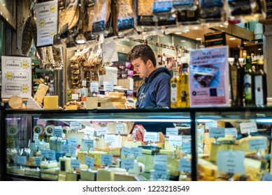 MELBOURNE, VICTORIA/AUSTRALIA - NOVEMBER 5, 2018: An unidentified male is behind the counter at a Queen Victoria Market delicatessen stall.