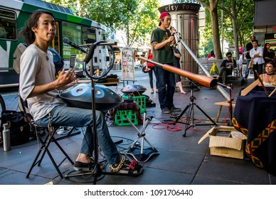 Melbourne/Australia - Feb 2017: Street musicians with traditional musical instruments of natives perform in the downtown.