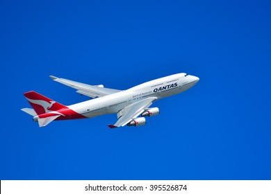 MELBOURNE,AUSTRALIA MARCH 15 2015: Qantas Airplane flies over Melbourne during Melbourne Formula One Grand Prix