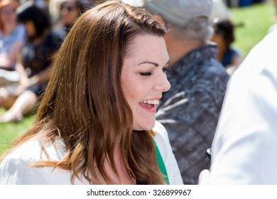 MELBOURNE/AUSTRALIA - OCTOBER 11: Greens Senator Sarah Hanson-Young speaking at a #StandUp4Refugees rally outside of the State Library in Melbourne on October 11 2015.