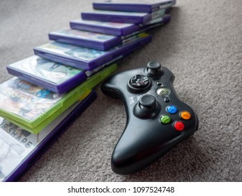 Melbourne,VIC/Australia-May 24th 2018: The Microsoft Xbox 360 Controller and some boxes of console games.