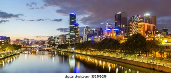 Melburne City, Yarra River with Reflection Cityscape Skyline background under dramatic Golden Sky Sunset at Dusk Twilight, Australia